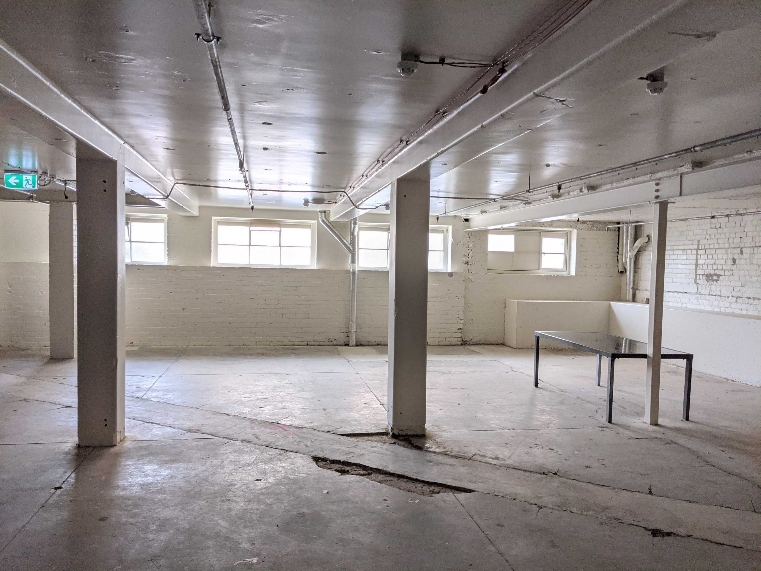 Interiors of an industrial space with white walls
